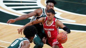 "Wisconsin's ""Maestro"" applies refreshing facial scrub to college basketball"